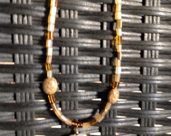 Beaded necklace with warm golden tones