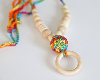 Wooden ring nursing necklace.  Girls crochet necklace. Colourful bead teething necklace.