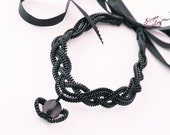 Women's braided necklace, handmade crown zipper charm, Goth style.
