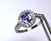 Flawless Genuine  Tanzanite in a Glowing Accented Halo Sterling Silver Setting