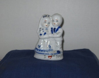 White Porcelain Bride And Groom Figurine.
