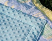"35"" x 27"" Baby Quilt with Light Blue Minky Back. Yellow, Light Blue Baby Print with Clouds, Moons, Rattles. Blue Polka Dot Minky Back."