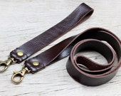 Soil brown leather neck strap and wristlet trap