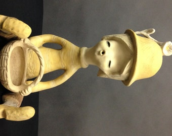 Vintage Planter Girl Unglazed clay holding a basket