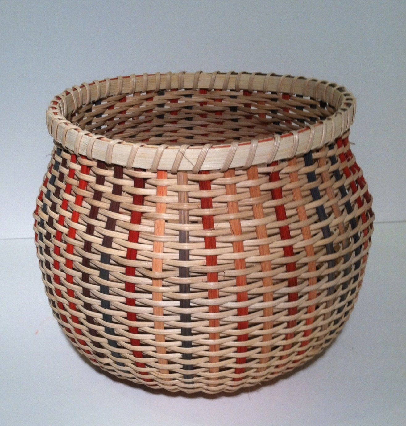 How To Weave A Basket Out Of Reeds : Woven twill basket in earth tones and natural reed