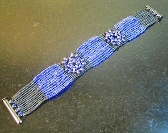 Wide purple and black Flower Bracelet