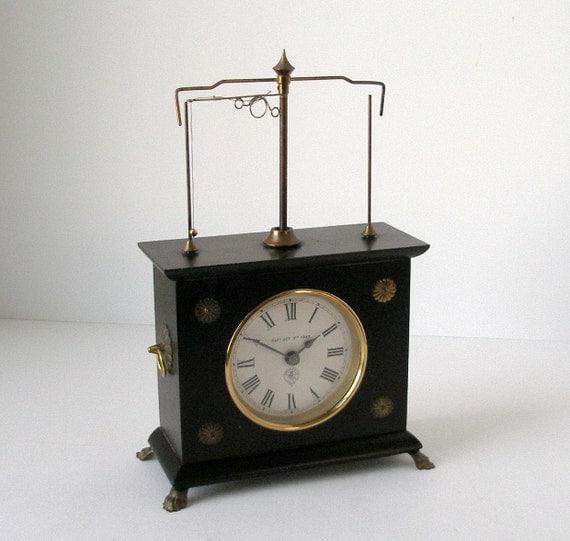 70s Horolovar Ignatz Flying Pendulum Clock Ebony By Fultonlane