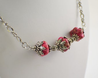 Pink jasper necklace fluted gemstone beads with pewter accents