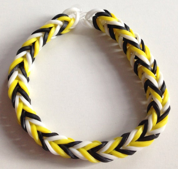 To yellow black and white fishtail rubber band bracelet on etsy