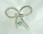 Vintage Bow Brooch with Blue Rhinestone in Silver Knot