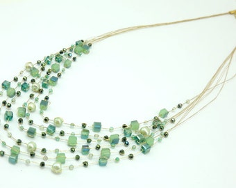 Multi strand green color crystal necklace.