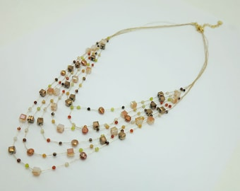 Multi stand brown crystal necklace.