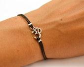 OM bracelet, women bracelet with Tibetan silver Om charm, Hindu symbol, black cord, gift for her, yoga bracelet, lucky charm, chakra jewelry