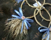 Wheat or grass and blue ribbon decorations