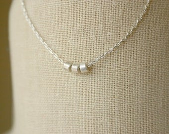 Sterling silver necklace with three silver beads