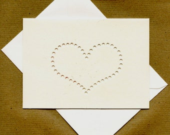 Hand drilled blank card with heart motif