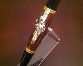 Pacifica Style Twist Roller ball pen with gold accents and King Wood Center. US Navy Information Dominance (ENL) Warfare Device on the clip.