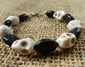 Skull stacking bracelet, black& white skull bracelet with magnesite and volcanic rock perfect for Halloween