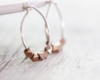 Rose gold nugget hoop earrings. Hammered hoops. Silver and rose gold small hoops. Hoops with rose gold plated silver nuggets.