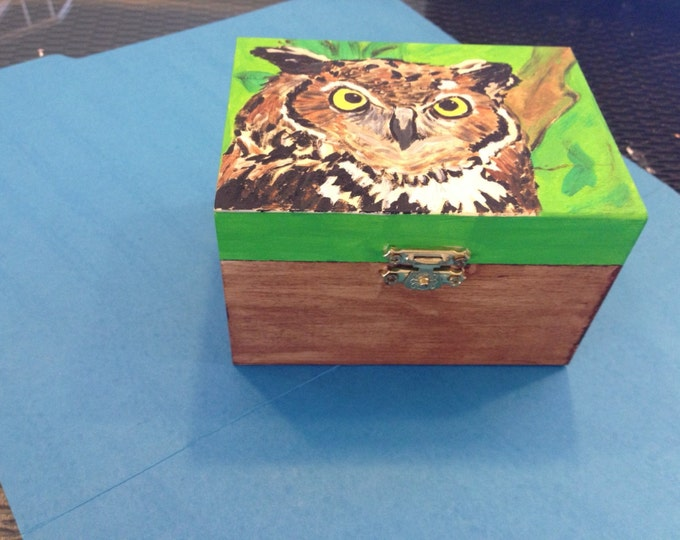 Solid Wood box, with front latch and hinges. Great Horned Owl painted in acrylics on top.