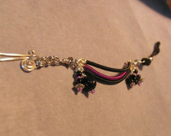 Black and pink coiled wire bracelet with Czech pressed fluted glass beads black agates suede chainmaille and handformed hook clasp