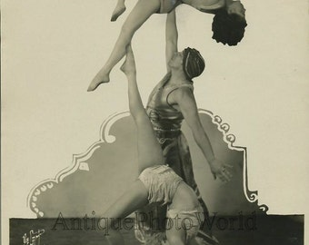 Ballet dancers acrobats in costumes antique art photo