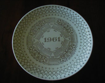Wonderful 10 1/4 inch 1961 calendar plate.  If this was the year you were born this a must have with gold writing and trim..