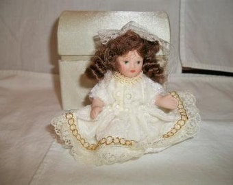 vintage miniature porcelain doll with brown hair