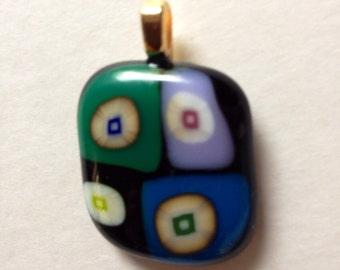 Multicolor circles in blocks of colors fused glass pendant