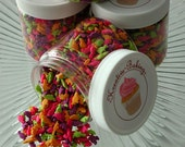 Dinosaur Sprinkle Mix-Comes in an assortment of green, yellow, pink and purple dinosaur sprinkles