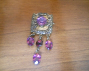 Vintage pin made from the combination of pieces of metal and stones truly one of a kind