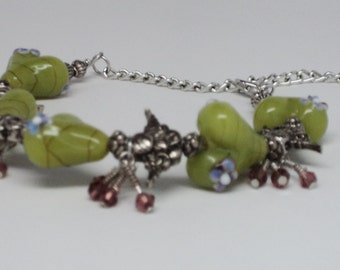 Sweetheart Green Glass Lampwork Beads with Blue Purple Flower on Silver Toned Adj Length Bracelet