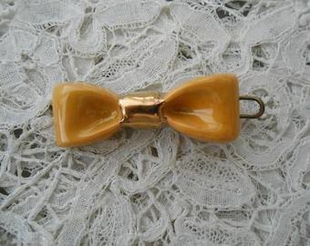 1930's hairslide/barette ceramic bow