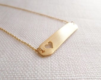 gold bar necklace with hollow out heart