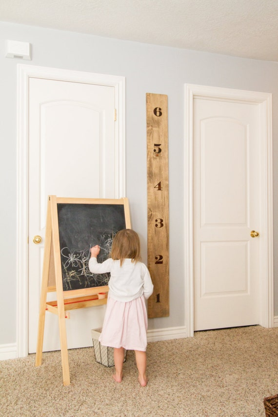 Regla de medir altura en madera