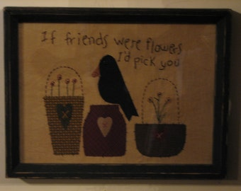 If Friends Were Flowers is a hand-stitchery in a wooden frame with glass