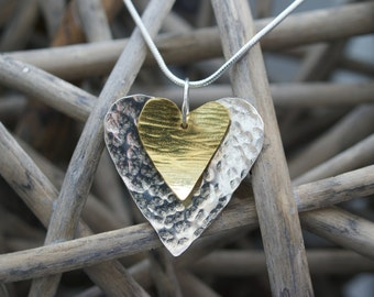Handmade silver and brass heart-shaped pendant