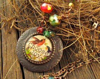 CHOOSE JOY Bronze Resin Filled Bezel Message Necklace and Colorful Green, Red, Faceted Czech Glass Wire Wrapped Beads on aTextured Chain.
