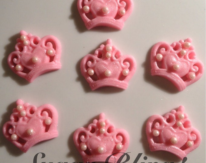 Pink fondant small sugar crowns.