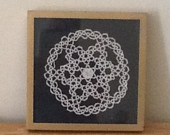 Gorgeous antique tatted doily with rose center in antiqued gold frame. On dark green Suede cloth. 11 x 11
