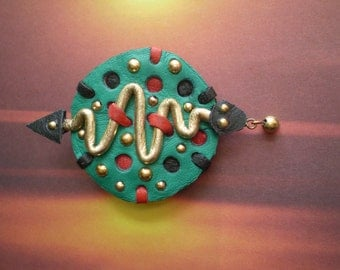 Leather Brooch...Green Shield with a Gold Snake.. brooch in recycled leather.