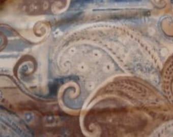 Whirls of blues, browns and beiges on Cotton fabric bty