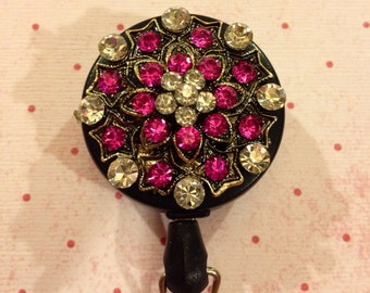 Pink crystal flower badge reel