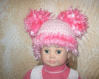 Hat for baby with fun with pompons. Hat for girls.