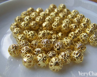 100 pcs of Gold Tone Filigree Ball Spacer Beads Size 6mm A232