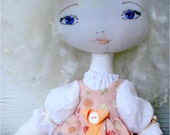 Beautiful gentle doll for the small princess.Doll curly-headed blonde. Game doll for the girl. Doll for game.