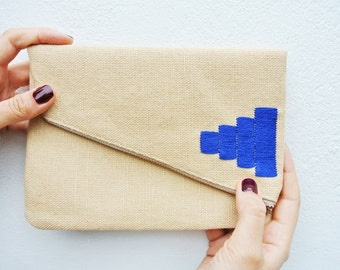 Fold over zipper clutch with embroidery detail