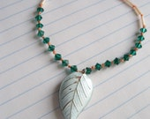 Blue Leaf and Emerald necklace - sarawolfiejewelry