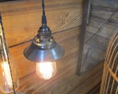 Brass pendant light with small aged brass shade and edison bulb
