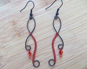 Black earrings wrapped in red wire with fire opal swarovski